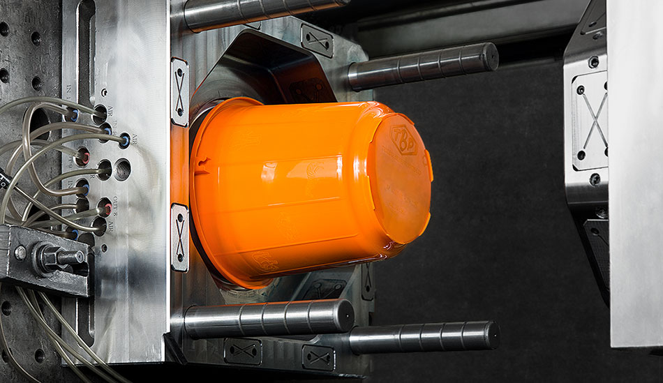 an-orange-bucket-in-injection-molding-process